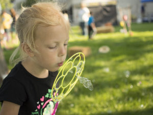 Blowing bubbles at the Kids Games of Old